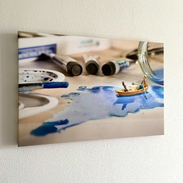 foto little people serie imagine and create aan de muur op kantoor